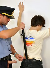 Young suspect in handcuffs used by a horny old cop